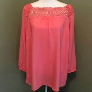 Salmon colored long sleeve silky top.